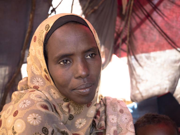 "Faduma Abdinor Mohamed, 39, was pregnant with her youngest child when both her father and husband were killed during armed attacks.   The compounding impact of drought left Faduma unable to feed and water her livestock, leaving her struggling to feed her children. When one of her sons became seriously ill, she sold her four surviving goats to pay for his medicine. She does not own any land but earned some money by working on other people's farms. When the drought deteriorated, it was not possible to find any more work.  Eventually, the combined pressure of conflict and drought forced Faduma to move to Baidoa, an urban centre with greater access to humanitarian assistance.  ""Children adapt to the place where they grow up and spend time.  I want my children to learn, to help their parents and build a future … and get an education that can give them opportunities everywhere. That is why I brought them here.""  With help from her brother, who lives in Mogadishu, Faduma is able to send her four oldest children to school, but she continues to struggling to provide enough for them enough to eat.   ""Last night we got something to eat from others. My children didn't eat anything this morning. I had nothing to cook.""  Photo: Ingrid Prestetun/NRC"
