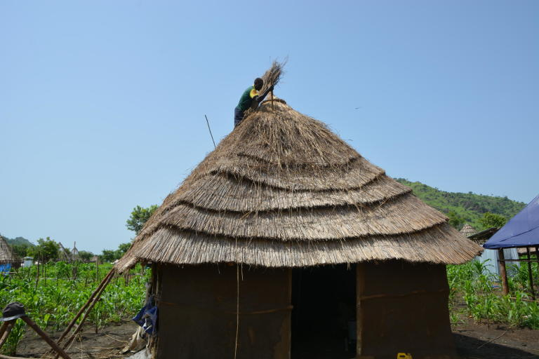 Refugees participate in roof thatching. Shelters in Tierkidi camp, Gambella. Photo Credit: NRC/Emebet Abdissa