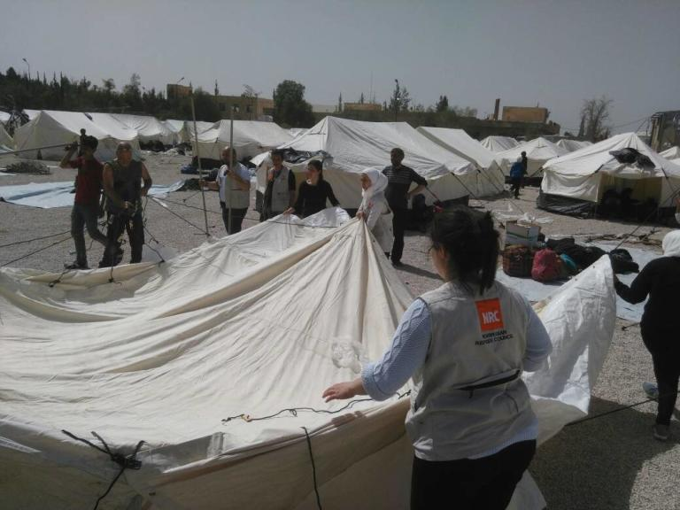 NRC teams at the Adra IDP Centre in Damascus responding to the massive influx of IDPs from Eastern Ghouta. The influx was sudden, with high numbers of children, together with women, men, youth and elderly persons.   Photo: NRC