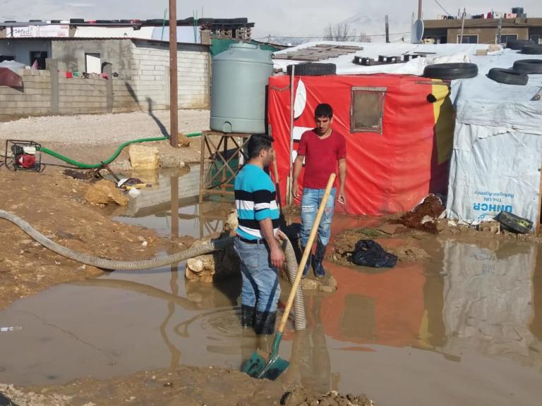 "NRC is dewatering informal tented settlements in Bekaa that were flooded after storm ""Norma"" hit Lebanon a few days ago causing damage to infrastructure, roads and homes across the country.  In some areas refugees have been forced to evacuate to alternative locations as tents have collapsed and informal tented settlements have flooded due to the heavy rain and snowfall. Photo: NRC WASH Team"