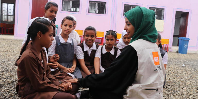 "NRC's Education Assistant in Aden, Malka Mohammed (26), remembers March, 2015 as a time that turned from being a joyful month of celebrations and weddings into a living nightmare. She was working as an English teacher in her home city of Aden when a colleague ran to her classroom, knocked madly on the door and shouted: ""They're attacking the city!""   ""We evacuated the school. There was a lot of confusion. There was shooting everywhere,"" she recounts. Over the next few weeks, it got worse and the fighting drew closer to Malka's home.   ""Every day, I heard stories of how people had been killed, and I saw the remains of destroyed buildings. It scared me to death. I was particularly afraid during those early morning hours when the airstrikes would begin.""  She remembers one day waking up to the screams of the little girl next door. ""I ran out to the street without wearing my abaya or even a scarf on my head. I was running like mad and the street was full of people. It felt like the end of the world, the sky was covered in red lightening.""  Malka and her mother ran as fast as they could. They eventually reached a house at which they felt safe and were welcomed in by the people living there. They stayed until the next morning.   A stranger helped Malka that day. Now, she is helping others.   As an EducationAssistant in southern Yemen, her job is to make sure children living in conflict can still access school. Through our education work, we rehabilitate and rebuild schools destroyed by shelling and other attacks, we distribute school materials, teach teachers and organise school meals.  ""We cannot lose education in Yemen. If we lose education, we can lose a whole generation,"" she says, and continues: ""Education is so important, and that's why we try to support young Yemenis to create a better life for themselves, and a future.""  Photo:"