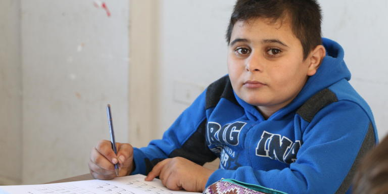 "Yazan, is enrolled with the Norwegian Refugee Council (NRC) first cycle of basic literacy and numeracy programme in Lebanon. He is learning English, Arabic, and mathematics. ""My favorite subject is Arabic. I think it's much easier than the English because it's very hard for me to understand the English words,"" Yazan explains.  Photo: Nadine Malli/NRC"