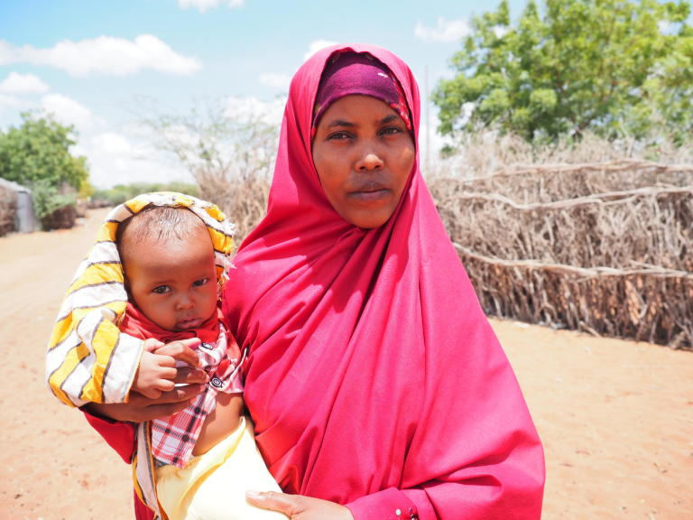 Halima Ahmed (24) and her 18-month-old son Mascud outside their home in Hagadera camp, Dadaab Refugee Complex, Kenya. Halima is planning to repatriate to Somalia with her four children and join her husband, who has already moved back to their country of origin after almost 10 years living as refugees.