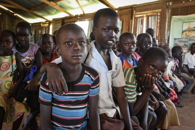 "Levi Hakim (in white shirt) has fled from Mukaya and found protection in Yei, where he is attending NRC's Education in Emergencies classes.   ""At the time we fled there were a lot of gunshots and we started to run. I was scared. We heard a lot of gunshots. The only thing we could bring was something for cooking and a jerry can. The mattresses and our other belongings were burned. Our house was set on fire. At the time we ran they had already set the house on fire. The whole family fled together.""  They were two sisters, six brothers,  him and his parents.   ""We were using a bike. My father was bringing me and a young sister by bike. We fled in the morning and reached here by 3 pm.""   ""The situation here is okay. School cleans my mind and makes me think that I can be a good person in the future. That is why I want to go to school.   In the future I want to repair vehicles. That is what I want to learn. To repair and to drive.  I am hoping for peace. If there is peace, people will live freely. If there is stability we will go back. If peace is there.""  The photo is from St. Thomas primary school in Yei, South Sudan. The school is providing education for children displaced by conflict - who have come to Yei for safety. NRC has built a new school building and latrines, and is running the education program with support from ECHO.  Photo: NRC/Tiril Skarstein"
