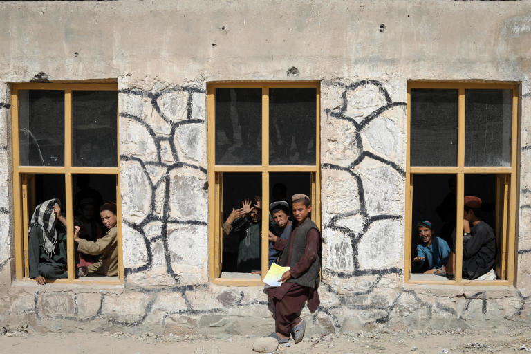 "This is Charamgar secondary school some 5KM on the northern side of Trinkot, Uruzgan Province. This school was occupied and used as a checkpoint by the Taliban for almost six months in 2015/16, but the school remain shut for whole academic year.  When the the Taliban were moved back and school resumed again, all the roofing, boundary walls and gates were either destroyed or was stolen.   NRC stepped forward and started doing some basic security upgrading to this and some three other schools in and around Trin Kot. The work includes; Iron sheets for the roofing of schools, installing emergency gates, main gates, building boundaries walls, grill work, windows repairing, glasses and blast films for the windows. NRC also established a schools-based Protection Committee (SBPCs) for each school with support and participation of PED, Community shura.  The school activities are closely monitored and checked by the community people, PED and the community has also been accountable to protect the schools from future expected incidents and they are also encouraging the families to get their children to school.  Repairing work and studies continues in this school and currently around 15 staff are teaching some 600 students in two different shifts.  ""We feel more safe and secure now after building the boundary walls and installing the gates. Now, we have bigger yard and students can play inside the school building. The boundary is also keeping safe from any attack and flying bullets,"" said Nida Mohammad, the Chramgar school principle. Photo: NRC/Enayatullah Azad"