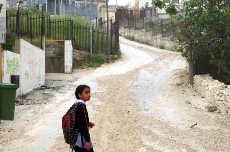 Muna's friend, Doa'a, 11, has to cross two checkpoints and take an enclosed pathway as a shortcut to school in Hebron's Tel Rumeida neighborhood.  Photo: Ivan Karakashian/NRC