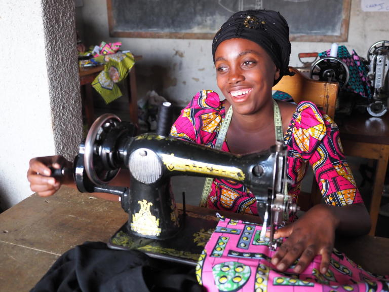 Rachel is twenty-years-old and lives with her parents, siblings and her 2-year-old daughter (name: Guylaine). She became pregnant when she was 17 with a boy from her village, but he disappeared when he revealed that she was expecting his child. Since August 2018, Rachel has been attending the NRC tailoring class in Kitchanga. These courses will last six months. After training, her dream is to start her own tailoring shop and to be able to give her daughter an education to in the future. She loves tailoring and she has made dresses for herself and her daughter. Before she was selected for the NRC tailoring class, she had nothing to do and now she is very happy to be able to attend the classes.   Rachel is from the village Ngingwe, Masisi territory, which is six kilometers from Kitchanga in the North Kivu province. She and her family had to flee during the night four years ago when the clashes broke out between armed groups. They travelled the whole night and reached Kitchanga in the morning. Rachel was very afraid when she had to flee and during this violence where she lost her grandmother and uncle. She misses them a lot. Rachel is still constantly afraid, and does not want to go back home until it's safe. Since the attack, some people from the village have been back home to pick up food and their belongings, but they cannot sleep there, as the situation is still unsafe. Rachel has not been back home in Ngingwe since she and her family fled their home.   Rachel does not feel safe in Kitchanga either. She is scared that armed groups will enter Kitchanga and take over the town in the future. She does not feel well about being a displaced youth in Kitchanga. It is a big challenge for her because she is sometimes neglected. Since she also a single mother, people austersize her.    There's also a lack of food in Kitchanga, and Rachel does not have enough money to pay school fees, therefore she dropped out of school after second grade in secondary school. Rachel also struggles to pay for health care and clothes for her daughter. After tailoring class, she usually helps her mother to do some household activities, for instance, fetching water and cooking dinner.     Photo: Ingrid Prestetun/NRC