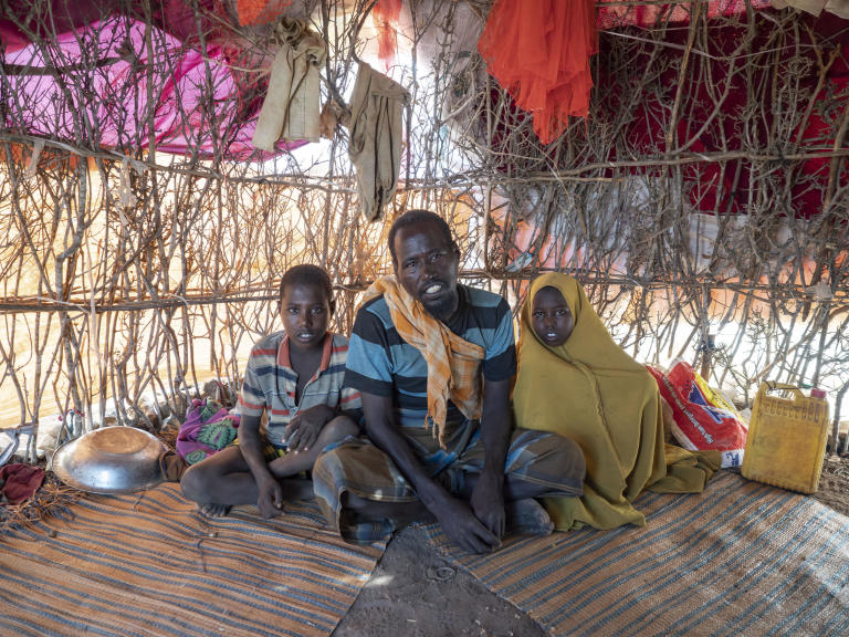 "Hassan Mohamed Abdi, 45, is a widower who lived as a farmer until recurrent drought over several years made it impossible to sustain his family. Hassan and his four children now live in a small shelter in the Ceel-ilaan displacement camp, outside Baidoa.  ""Over the four years this drought has lasted, we have planted on our farms and the harvest has given no result. For a while we survived by working for others. We decided to flee to the city because we couldn't continue living in the village on account of the drought. That is why we came to the city, to ask for assistance from the humanitarian organisations.""  Like many people displaced to Baidoa, Hassan was forced to flee to assistance because insecurity prevents humanitarian assistance from reaching his home area.  The two children in the photo: Kulmiyz, 7 years old. Halima, 5 years old.  Photo: Ingrid Prestetun/NRC"