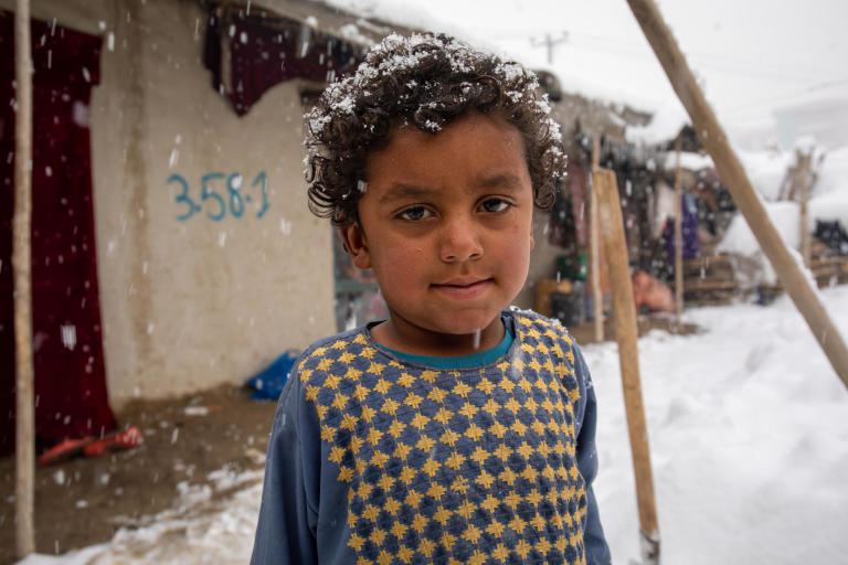 "Hasibullah, 4, is Salma's brother.  ""He has only one Jacket and I washed that thinking it won't snow sometimes soon,"" says her mother. ""No he has to wait until it gets dried.""  ""I'm afraid he might get sick as he doesn't have any spare jacket and he doesn't stay at home. he gets out every now and then to play with his friends and enjoy the snow."" ended her mother. Photo: Enayatullah Azad/NRC"